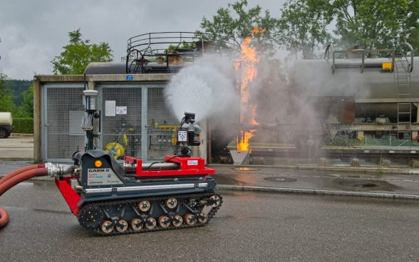 Fire extinguishing robot in use during an unpredictable chemical accident