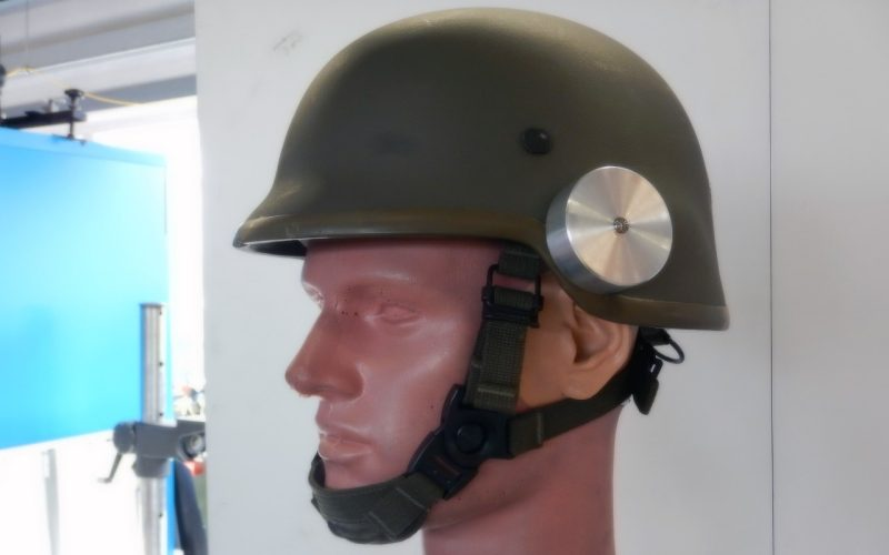 Artificial head with fitted helmet and mounted sensors