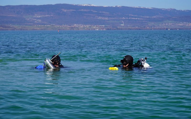 Divers collect water and sediment samples